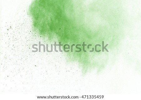 Abstract green powder splatted on white background