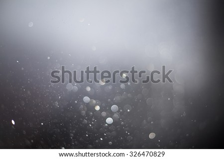 Abstract grey bokeh background - stock photo