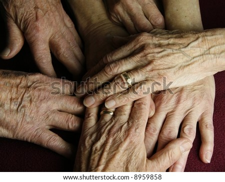 abstract grouping of elderly hands - stock photo