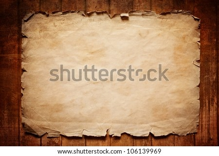 Abstract grunge background - old broken horizontal sheet of paper on brown wooden board - stock photo