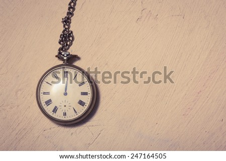 abstract grunge background with old-fashioned retro watch with chain  - stock photo