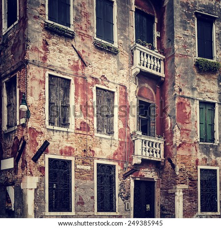 Abstract grungy old wall background, vintage building facade, traditional Italian architecture, venetian aged exterior, Venice, Italy - stock photo