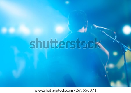 Abstract guitarist on stage for background, blank text, soft focus and blur - stock photo