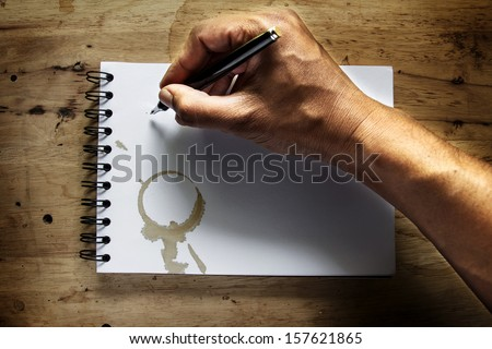 Abstract hand man writing on the grunge paper. - stock photo