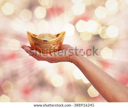 abstract Handle gold with a golden background bokeh. The doctrine of the Bible about money and gold.  - stock photo