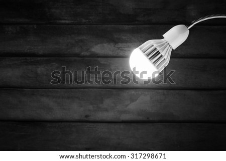 abstract hanging white lamp with old wooden wall background. - stock photo