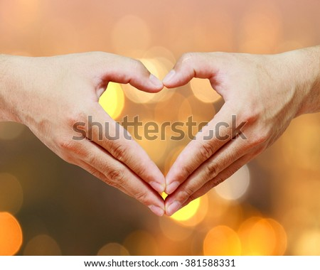 abstract Heart Shaped with a golden background bokeh. Pray for Christians. Prayer to bless our world. The Society of the Capital - stock photo