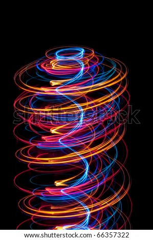 abstract helter skelter composed of spirals of glowing light - stock photo