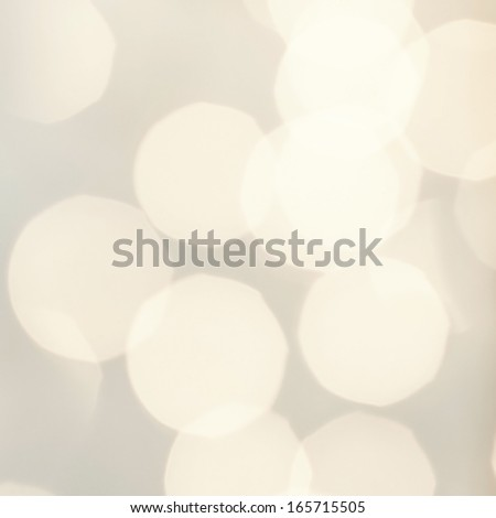 Abstract holiday background. Vintage lights, glowing magic bokeh, retro style. white and gray  lights with blur effect.