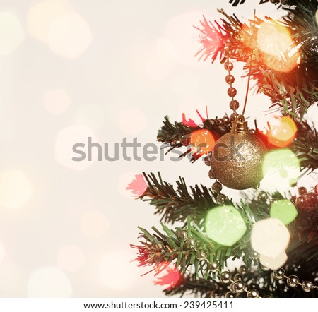 Abstract holiday background with Christmas tree detail and lights - stock photo