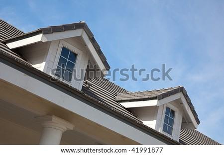 Abstract House Facade Against a Blue Sky - stock photo