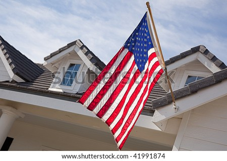 Abstract House Facade & American Flag Against a Blue Sky - stock photo