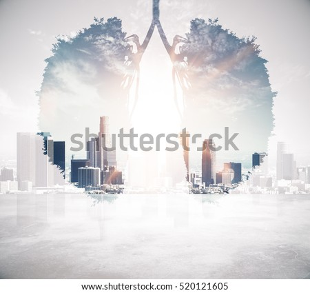 Abstract human lungs on modern city background. Environment and health concept. Double exposure