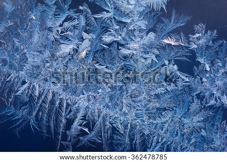 Abstract ice pattern on winter glass - stock photo