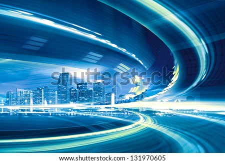 Abstract Illustration of an urban highway going to the modern city downtown, speed motion with colorful light trails. - stock photo
