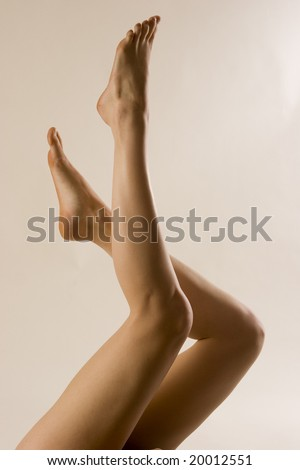 Abstract image of a beautiful pair of woman's legs. - stock photo