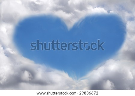 Abstract image of a heart formed by clouds in a blue sky. - stock photo
