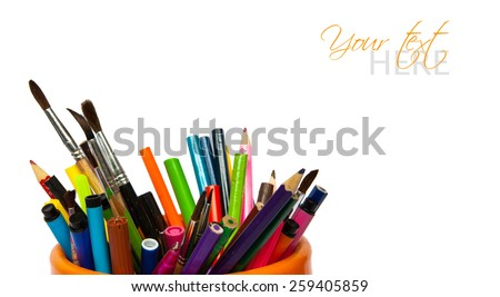Abstract image of a several pens, pencils, and markers. - stock photo