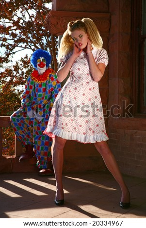 Abstract Image of a Tall Beautiful Woman Being Watched by a Sinister Clown