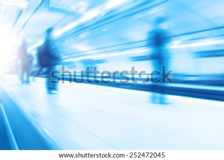 Abstract image of blurred people at  subway station. - stock photo