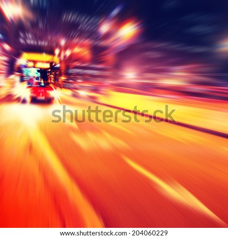 Abstract image of bus in motion blur in the city. - stock photo