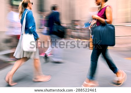 abstract image of business people in the street and modern style with a blurred background and using filter - stock photo
