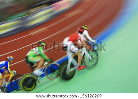 abstract image of cyclists running - stock photo