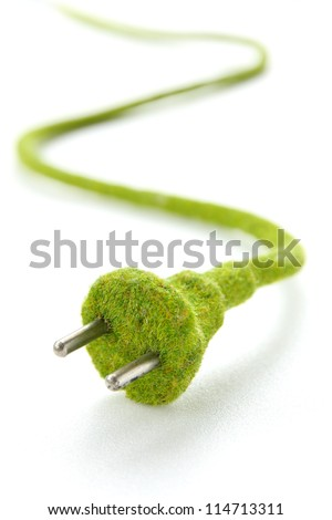 abstract image of green electric plug , save energy concept - stock photo