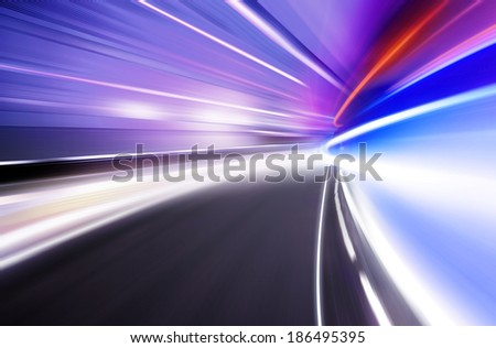Abstract image of night lights in the city with motion blur - stock photo