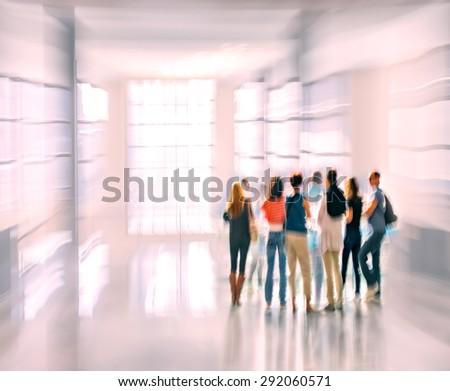 abstract image of people in the lobby of a modern business center with a blurred background and  using filter - stock photo