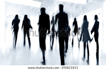 abstract image of people in the lobby of a modern business center with a blurred background and monochrome blue tonality - stock photo