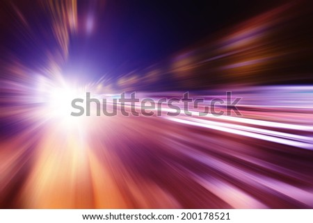 Abstract image of speed motion in the city at twilight. - stock photo
