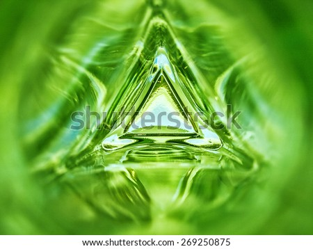 Abstract image of the inside of a triangle glass bottle emerald green color background - stock photo