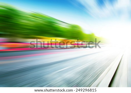 Abstract image of traffic lights in motion blur on the city street. - stock photo