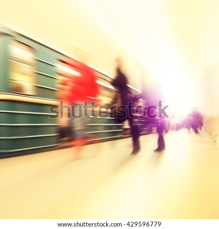 Abstract image of train in motion blur and blurred people at subway station.