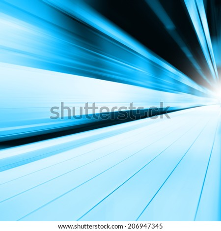 Abstract image of train in motion blur in subway station. - stock photo
