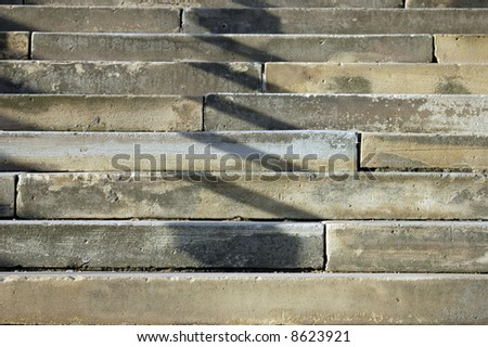 abstract image of weathered stone steps outside of a building in london - stock photo