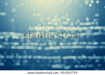 abstract image, water through the aquarium glass close up, retro vintage style filter effect - stock photo