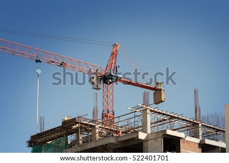 Abstract Industrial background with construction cranes, Morning sky with outbuildings.