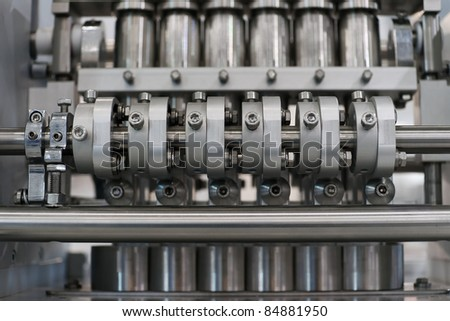 Abstract industrial mechanical device with valves - stock photo