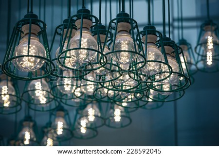 Abstract interior fragment. Stylized vintage illumination with modern LED lamps in metal lampshades - stock photo