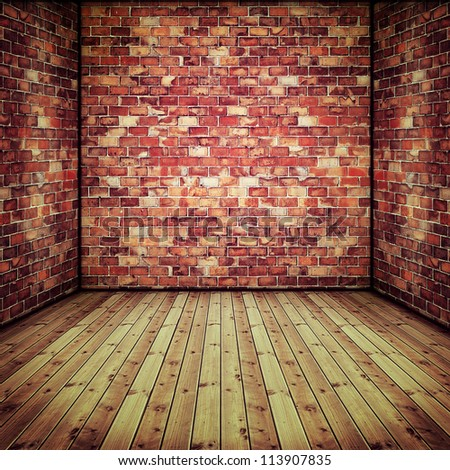 Abstract interior with old brick wall and wooden floor - stock photo