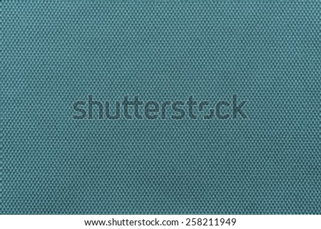 abstract interlacing texture of textile fabric of indigo color for empty and pure backgrounds - stock photo