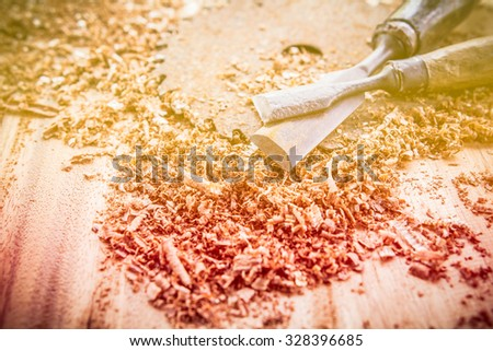 Abstract joiner tools on wood table background.made with color filters,blurred focus. - stock photo