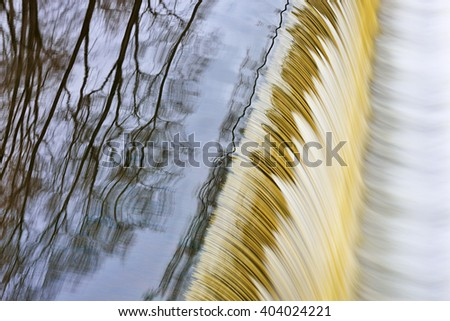 Abstract landscape of the Battle Creek River Cascade captured with motion blur, Michigan, USA - stock photo
