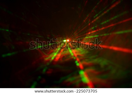 Abstract laser light on black background - stock photo