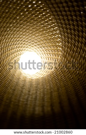 Abstract light at the end of a textured tunnel - stock photo