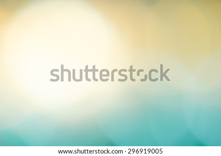 Abstract Light Bokeh Blue and Orange Pastel Soft Color Blurred Background - stock photo