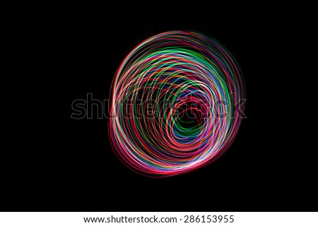 Abstract Light long exposure on dark background. - stock photo