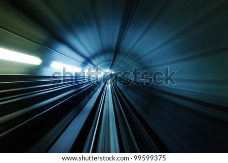 Abstract light trail accelerating through a tunnel. - stock photo